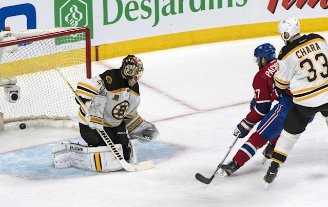 Montreal Canadiens' Max Pacioretty, center, scores on Boston Bruins goalie Tuukka Rask as Bruins defenceman Zdeno Chara (33) looks on during the second period of a second-round NHL playoff hockey game Monday, May 12, 2014, in Montreal. (AP Photo/The Canadian Press, Paul Chiasson)