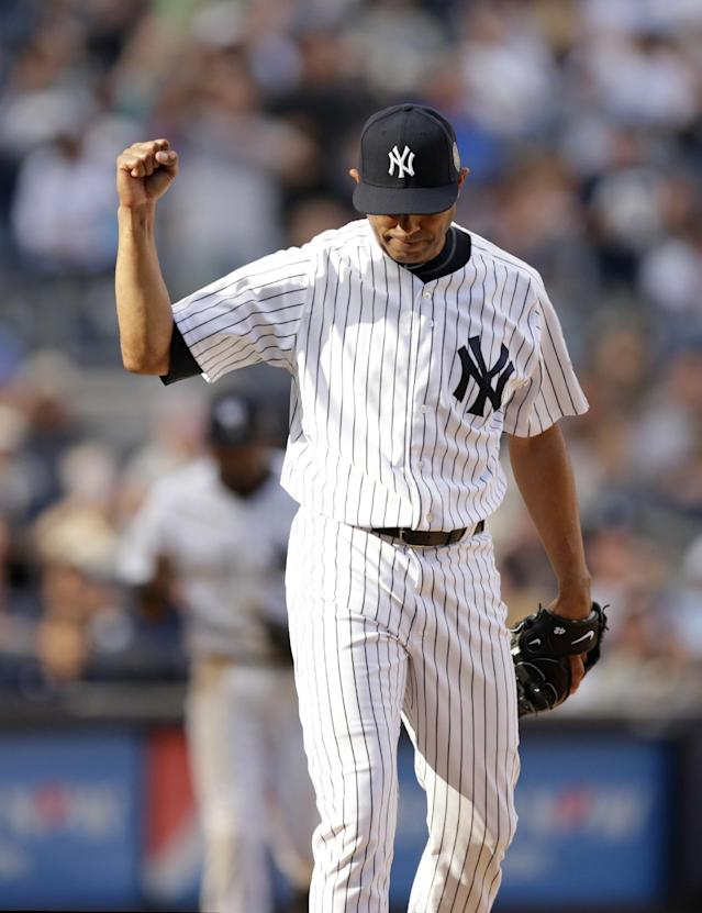New York Yankees relief pitcher Mariano Rivera (42) reacts after San Francisco Giants Hunter Pence hit into a ninth-inning double play in a baseball game against the New York Yankees, Sunday, Sept. 22, 2013, in New York. (AP Photo/Kathy Willens)