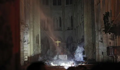 Smoke rises from ground inside the towers. Source: AP