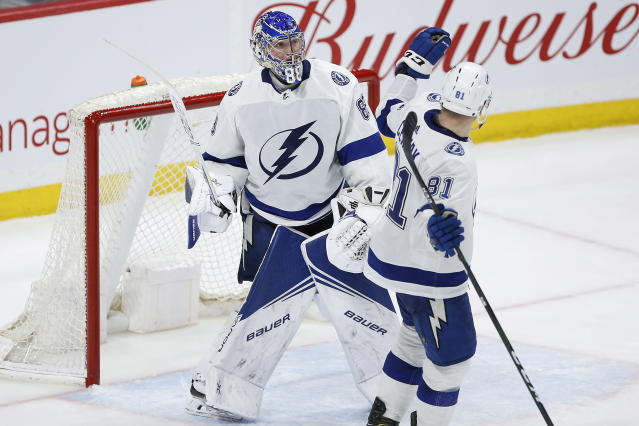 Tampa Bay Lightning goaltender Andrei Vasilevskiy (88) and Erik Cernak (81) celebrate a win over the Winnipeg Jets in NHL hockey game action in Winnipeg, Manitoba, Friday, Jan. 17, 2020. (John Woods/The Canadian Press via AP)