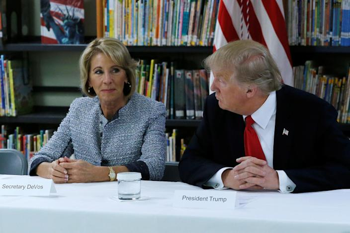 U.S. President Donald Trump and DeVos on March 2017. (Photo: REUTERS/Jonathan Ernst)