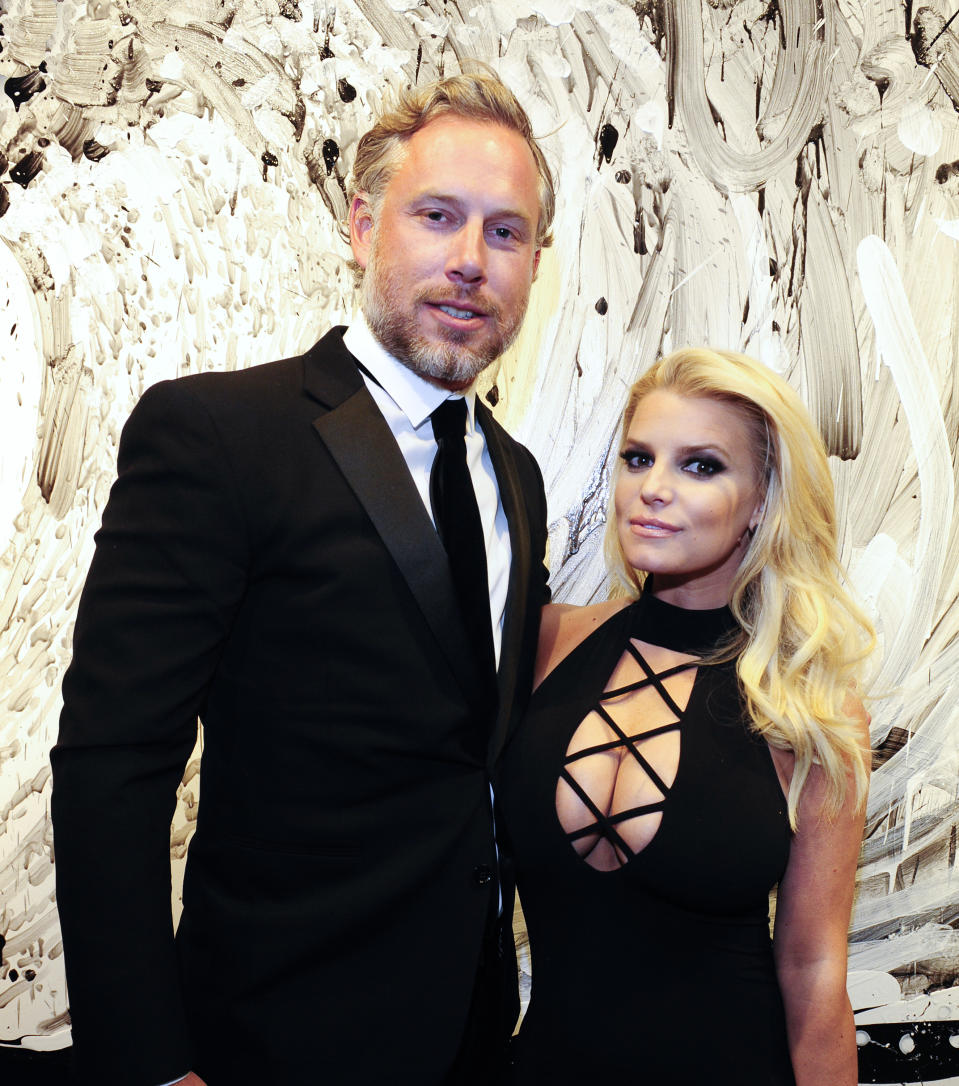 """BEVERLY HILLS, CA - FEBRUARY 27:  Eric Johnson and Jessica Simpson attend the """"Tom Everhart """"Raw"""" Exhibition of His Schulz-influenced Paintings For The First Time In Black And White At Mouche Gallery on February 27, 2016 in  Beverly Hills, California.  (Photo by Amy Graves/WireImage)"""