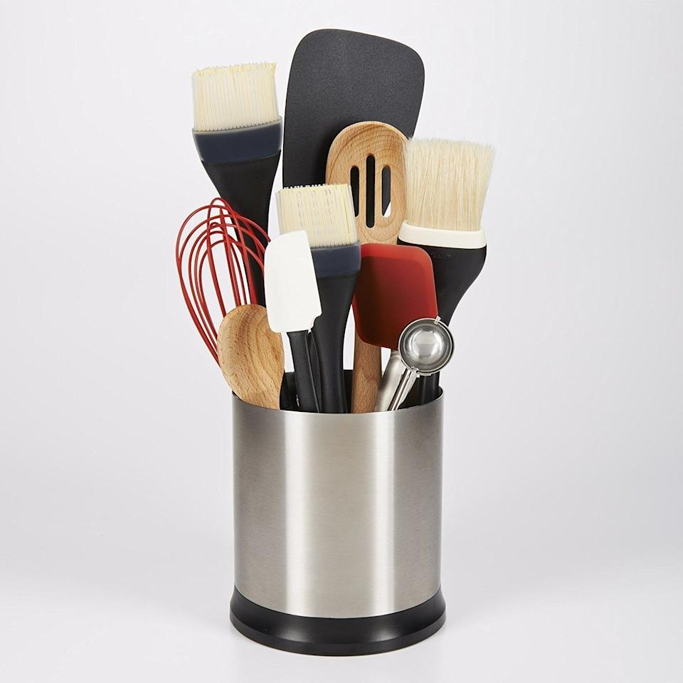 """You can spin away and grab whatever you need. Sometimes the simplest kitchen gadgets are truly the most helpful.<br /><br /><strong>Promising review:</strong>""""I cook a LOT. I had a utensil holder, but it wasn't big enough so it was hard to slide the utensils in — and if it was semi-empty, they were tilting and falling. I threw it away and used a drawer but then was super sick of digging through everything to get what I needed, especially when you have something on the stove and you need it pronto. I ordered this and love it.<strong>It rotates so you can spin it around to get what you need really quickly, has three dividers in it (so the utensils aren't falling over every time you pull one out), and is big enough to fit everything.</strong>I have maxed it out with all my utensils — I have 16 cooking utensils in it at a time. It also looks really nice and sleek on the counter. I highly recommend this product."""" —<a href=""""https://www.amazon.com/dp/B003M8GMYA?tag=huffpost-bfsyndication-20&ascsubtag=5833640%2C41%2C43%2Cd%2C0%2C0%2C0%2C962%3A1%3B901%3A2%3B900%3A2%3B974%3A3%3B975%3A2%3B982%3A2%2C16261686%2C0"""" target=""""_blank"""" rel=""""noopener noreferrer"""">Jessie<br /></a><br /><strong>Get it from Amazon for<a href=""""https://www.amazon.com/dp/B003M8GMYA?tag=huffpost-bfsyndication-20&ascsubtag=5833640%2C41%2C43%2Cd%2C0%2C0%2C0%2C962%3A1%3B901%3A2%3B900%3A2%3B974%3A3%3B975%3A2%3B982%3A2%2C16261686%2C0"""" target=""""_blank"""" rel=""""noopener noreferrer"""">$19.47</a>.</strong>"""