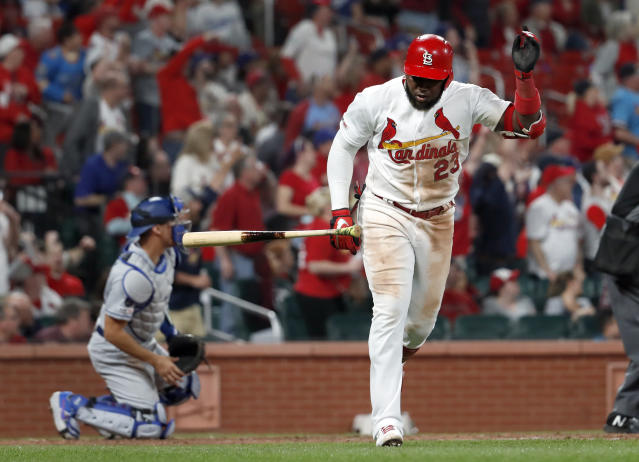 St. Louis Cardinals' Marcell Ozuna (23) tosses aside his bat as Los Angeles Dodgers catcher Austin Barnes, left, watches a two-run home run by Ozuna during the eighth inning of a baseball game Wednesday, April 10, 2019, in St. Louis. (AP Photo/Jeff Roberson)