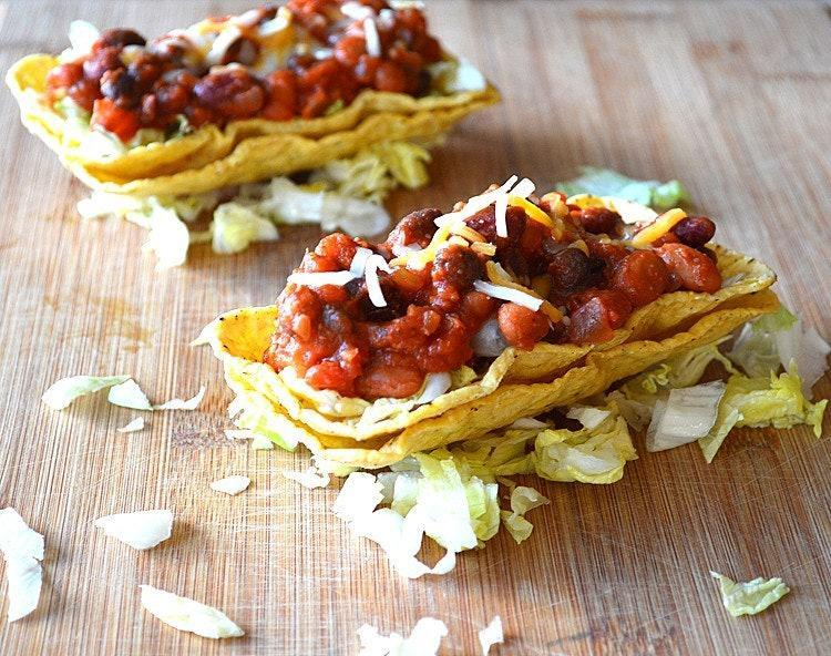 """<p>Vegan chili in a taco shell. So simple, yet so satisfying.</p> <p>Get the recipe <a href=""""https://theveglife.com/vegan-three-bean-chili-tacos/"""" rel=""""nofollow noopener"""" target=""""_blank"""" data-ylk=""""slk:here"""" class=""""link rapid-noclick-resp"""">here</a>.</p>"""