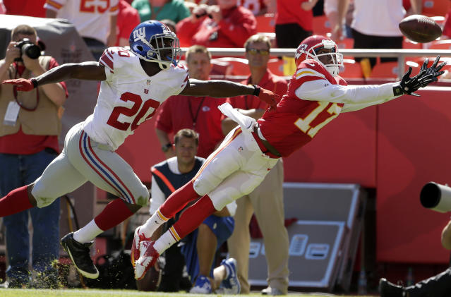 Kansas City Chiefs wide receiver Donnie Avery (17) dives for the ball while covered by New York Giants cornerback Prince Amukamara (20) during the second half of an NFL football game at Arrowhead Stadium in Kansas City, Mo., Sunday, Sept. 29, 2013. The pass was incomplete. (AP Photo/Charlie Riedel)