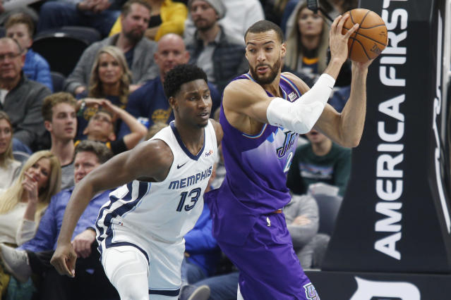 Utah Jazz center Rudy Gobert (27) grabs a rebound from Memphis Grizzlies forward Jaren Jackson Jr. (13) during the first half of an NBA basketball game Saturday, Dec. 7, 2019, in Salt Lake City. (AP Photo/George Frey)