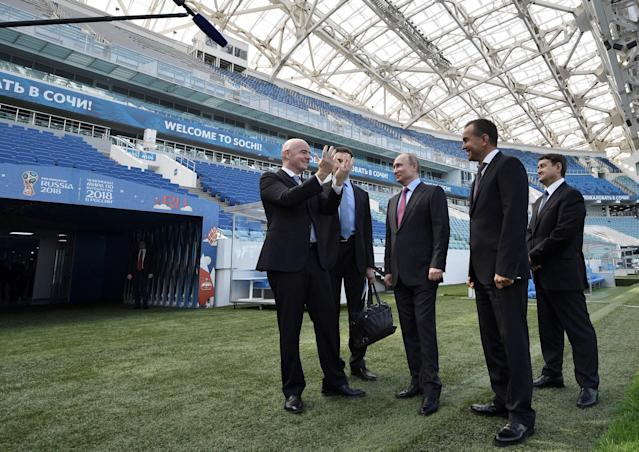 Russian President Vladimir Putin (C) and FIFA President Gianni Infantino (L) visit the Fisht Stadium, which will host matches of the 2018 FIFA World Cup in Sochi, Russia May 3, 2018. Sputnik/Aleksey Nikolskyi/Kremlin via REUTERS ATTENTION EDITORS - THIS IMAGE WAS PROVIDED BY A THIRD PARTY.