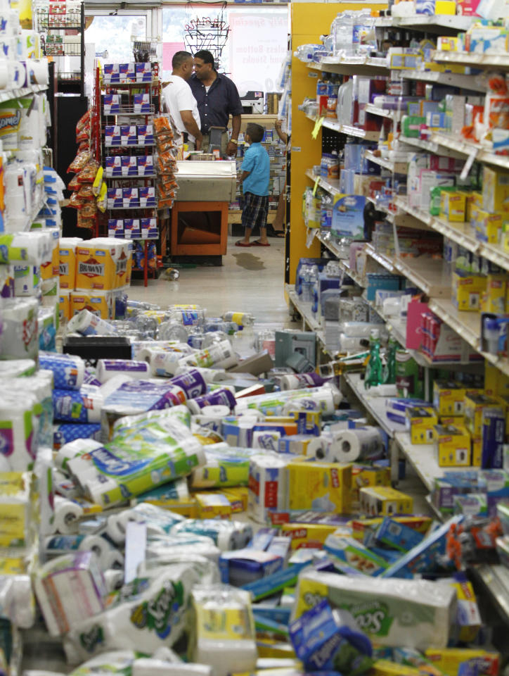 Debris covers the floor of the Miller's Mart food store in Mineral, Va., a small town northwest of Richmond near the earthquake's epicenter, Tuesday, Aug. 23, 2011. The most powerful earthquake to strike the East Coast in 67 years shook buildings and rattled nerves from South Carolina to Maine. (AP Photo/Steve Helber)