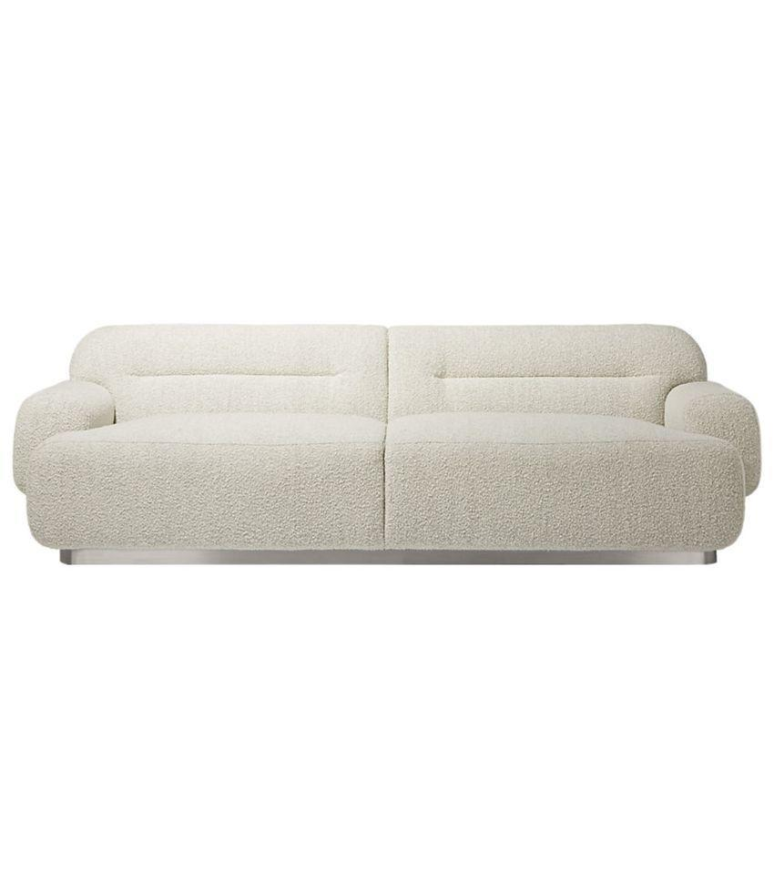 This boucle rounded sofa screams 1983 (and we're into it).