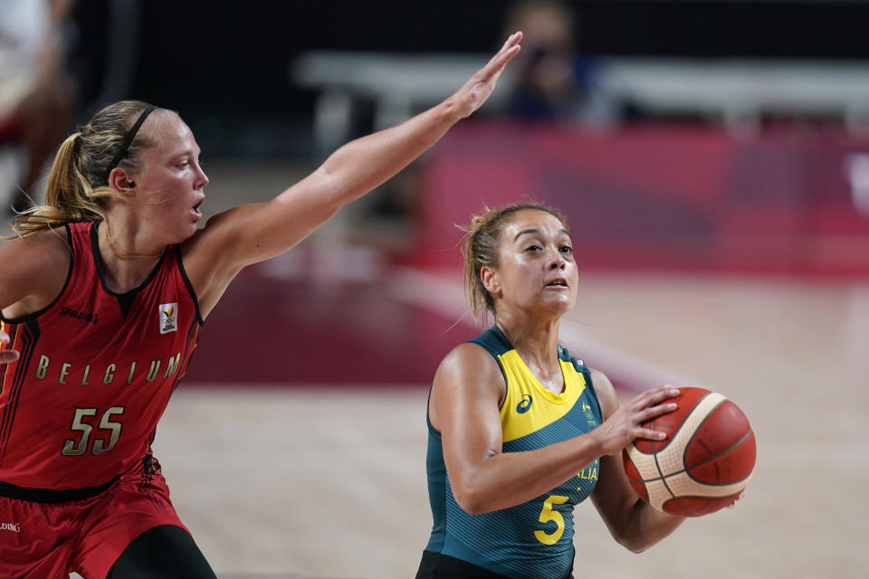 Australia's Leilani Mitchell (5) drives to the basket ahead of Belgium's Julie Allemand (55) during a women's basketball preliminary round game at the 2020 Summer Olympics, Tuesday, July 27, 2021, in Saitama, Japan. (AP Photo/Charlie Neibergall)