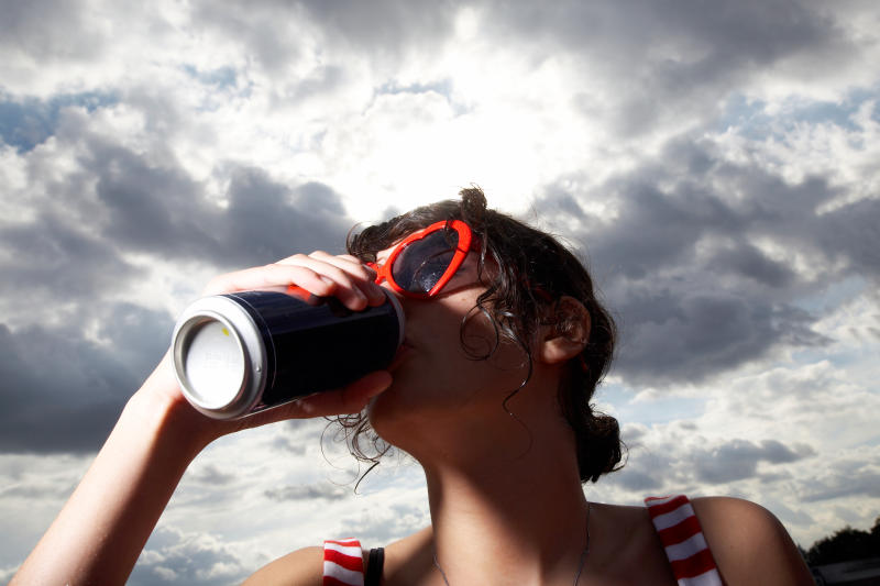 Girl drinking from a can