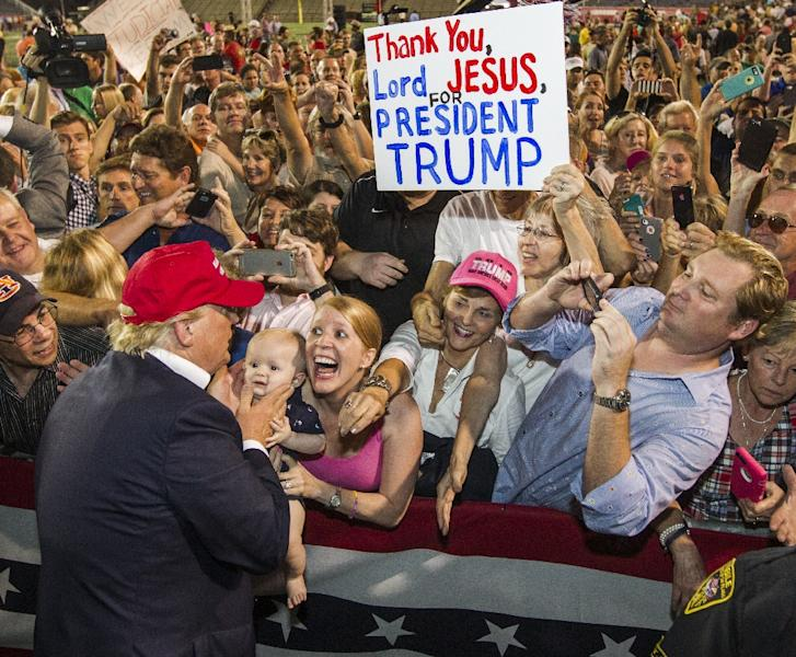 Republican presidential candidate Donald Trump greets supporters after his rally at Ladd-Peebles Stadium in Mobile, Alabama, on August 21, 2015 (AFP Photo/Mark Wallheiser)
