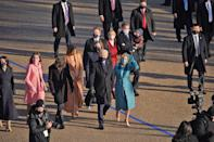"""<p>President Biden strolls down Pennsylvania Avenue <a href=""""https://people.com/politics/meet-joe-biden-and-kamala-harris-families/"""" rel=""""nofollow noopener"""" target=""""_blank"""" data-ylk=""""slk:surrounded by his family"""" class=""""link rapid-noclick-resp"""">surrounded by his family</a>, including wife Jill, daughter Ashley and son Hunter, and his grandchildren. </p>"""