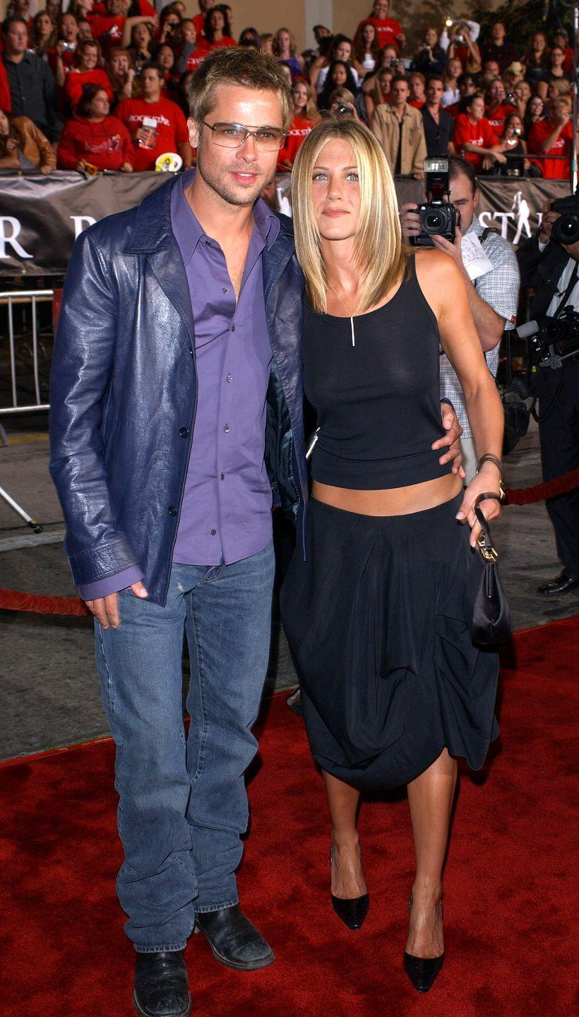 <p>The purple leather jacket. The purple button-up. The bare midriff on Hollywood's girl next door. Show us something more early 2000s than this.</p>