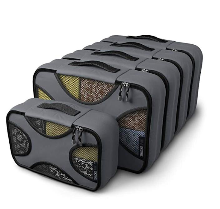 """<a href=""""https://amzn.to/38FiL4y"""" rel=""""nofollow noopener"""" target=""""_blank"""" data-ylk=""""slk:A set of packing cubes"""" class=""""link rapid-noclick-resp"""">A set of packing cubes</a> will have your giftee saying goodbye to that constant state of disorganization they experience when they&rsquo;re away from home. <a href=""""https://amzn.to/38FiL4y"""" rel=""""nofollow noopener"""" target=""""_blank"""" data-ylk=""""slk:Grab a set from Amazon"""" class=""""link rapid-noclick-resp"""">Grab a set from Amazon</a>, or <a href=""""https://fave.co/2PKpIsa"""" rel=""""nofollow noopener"""" target=""""_blank"""" data-ylk=""""slk:grab a pair from Away"""" class=""""link rapid-noclick-resp"""">grab a pair from Away</a> to go with <a href=""""https://fave.co/2tb7tEE"""" rel=""""nofollow noopener"""" target=""""_blank"""" data-ylk=""""slk:their new Away mini suitcase"""" class=""""link rapid-noclick-resp"""">their new Away mini suitcase</a>."""
