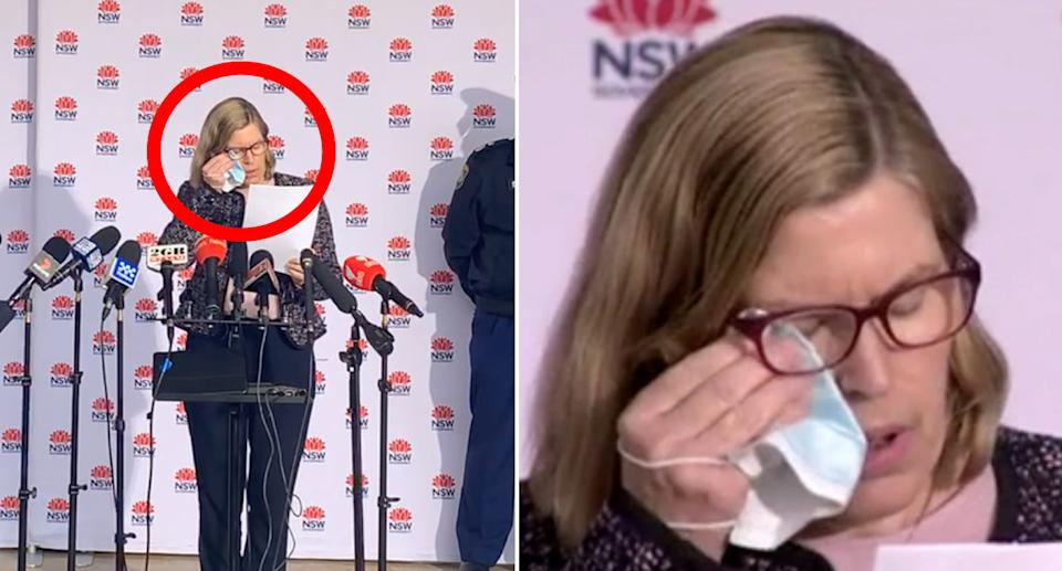 Dr Kerry Chant wiped her eye with her face mask as the state watched on on Friday. Source: ABC