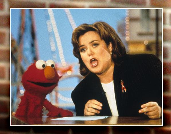 """Elmo doesn't just stick to daytime. He's had many friends in high places, but his biggest champion may have been <a href=""""http://search.yahoo.com/search?p=rosie+o'donnell+elmo&cs=bz&fr=buzz"""" rel=""""nofollow"""">Rosie O'Donnell</a>. He was a regular on her daytime TV show, and that in turn opened up the <a href=""""http://muppet.wikia.com/wiki/Elmo_Guest_Appearances"""" rel=""""nofollow"""">magical talk-show circuit</a>. Elmo cooked on """"<a href=""""http://muppet.wikia.com/wiki/Martha"""" rel=""""nofollow"""">Martha</a>,"""" sang on """"The Tony Danza Show,"""" <a href=""""http://www.npr.org/player/v2/mediaPlayer.html?action=1&t=1&islist=false&id=6169709&m=6169710"""" rel=""""nofollow"""">answered a quiz</a> on """"Wait Wait Don't Tell Me,"""" kissed co-host Joy Behar on """"<a href=""""http://www.tvsquad.com/2010/05/07/joy-behar-and-elmo-kiss-on-the-view-video/"""" rel=""""nofollow"""">The View</a>,"""" made healthy meals on """"<a href=""""http://www.foodnetwork.com/emeril-live/healthy-start/index.html"""" rel=""""nofollow"""">Emeril Live</a>,"""" dispensed dating advice (""""Elmo doesn't wear anything so Elmo thinks you should wear nothing"""") on """"<a href=""""http://www.youtube.com/watch?v=TRFefLewTag&feature=player_embedded#"""" rel=""""nofollow"""">The Tyra Banks Show</a>,"""" and shared his rapper name with Ice-T on """"<a href=""""http://www.nbc.com/late-night-with-jimmy-fallon/video/episodes/#vid=1087215"""" rel=""""nofollow"""">The Jimmy Fallon Show</a>."""" (Elmo's rapper name by the way... Wild Cherry.) Rosie also helped trigger one of the biggest toy hysteria of all time..."""