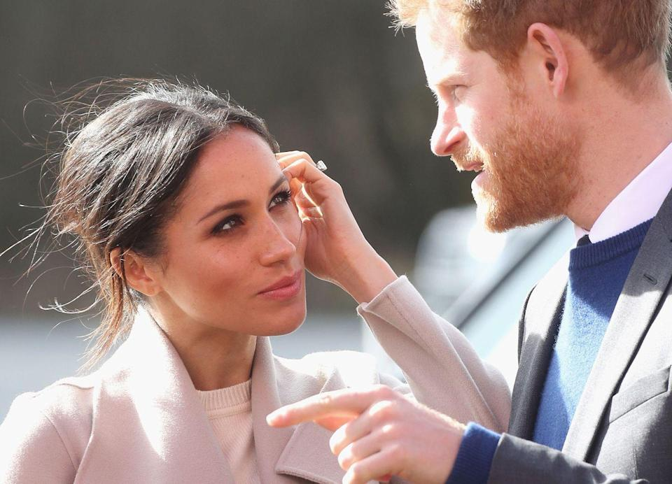 """<p>The lovebirds visited the Eikon Centre during a <a href=""""https://www.harpersbazaar.com/celebrity/latest/a19572201/prince-harry-meghan-markle-visit-ireland/"""" rel=""""nofollow noopener"""" target=""""_blank"""" data-ylk=""""slk:March trip to Northern Ireland"""" class=""""link rapid-noclick-resp"""">March trip to Northern Ireland</a>, where someone stole into this adorable moment of a windswept Meghan admiring Harry.</p>"""