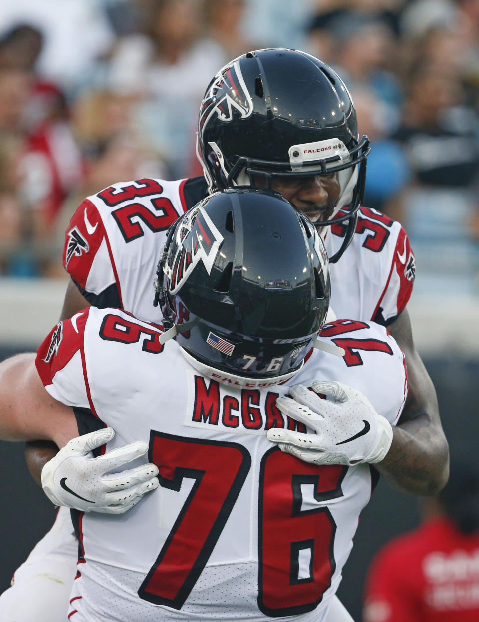 Atlanta Falcons running back Qadree Ollison (32) celebrates his 9-yard touchdown run against the Jacksonville Jaguars with offensive tackle Kaleb McGary (76) during the first half of an NFL preseason football game Thursday, Aug. 29, 2019, in Jacksonville, Fla. (AP Photo/Stephen B. Morton)