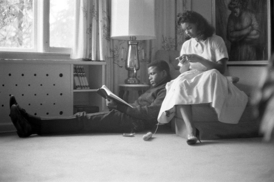 <p>Relaxing with his first wife, Juanita Hardy, at their home in New York City in 1959. Together, they had four daughters. </p>