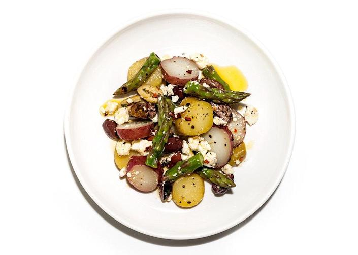 """There's nothing even remotely mushy about this tomato salad, which earns welcome texture from crunchy asparagus—and a hit of brine and chew from the olives. Oh, and did we mention there's cheese? <a href=""""https://www.bonappetit.com/recipe/potato-salad-with-asparagus-and-olives?mbid=synd_yahoo_rss"""" rel=""""nofollow noopener"""" target=""""_blank"""" data-ylk=""""slk:See recipe."""" class=""""link rapid-noclick-resp"""">See recipe.</a>"""