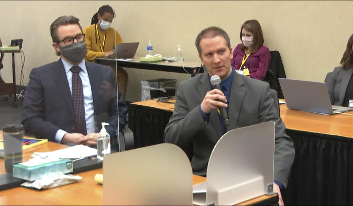 In this image from video, defense attorney Eric Nelson, left, and defendant, former Minneapolis police officer Derek Chauvin address Hennepin County Judge Peter Cahill during motions before the court Thursday, April 15, 2021, in the trial of Chauvin, at the Hennepin County Courthouse in Minneapolis. Chauvin is charged in the May 25, 2020 death of George Floyd. Chauvin told the judge he will not testify on his own behalf. (Court TV via AP, Pool)