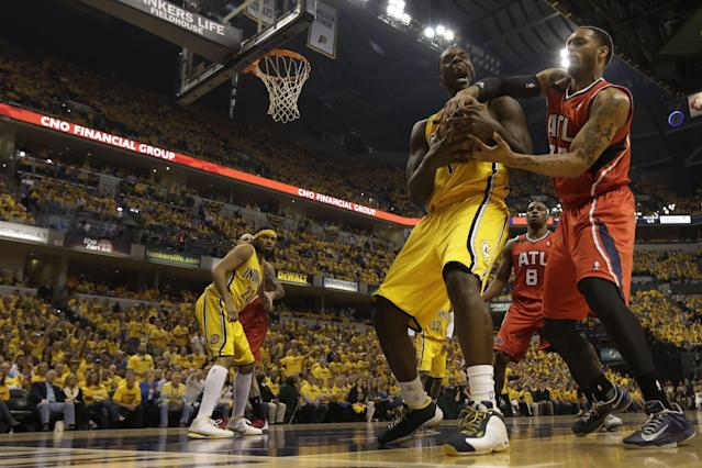 Indiana Pacers guard Lance Stephenson, front left, fights for control of a rebound with Atlanta Hawks forward Elton Brand in the first half during Game 7 of a first-round NBA basketball playoff series in Indianapolis, Saturday, May 3, 2014. (AP Photo/AJ Mast)
