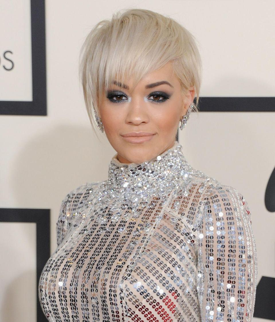 <p>The singer went all out at the 2015 Grammy Awards, pairing her ice-blond crop with a full-length crystal dress</p>