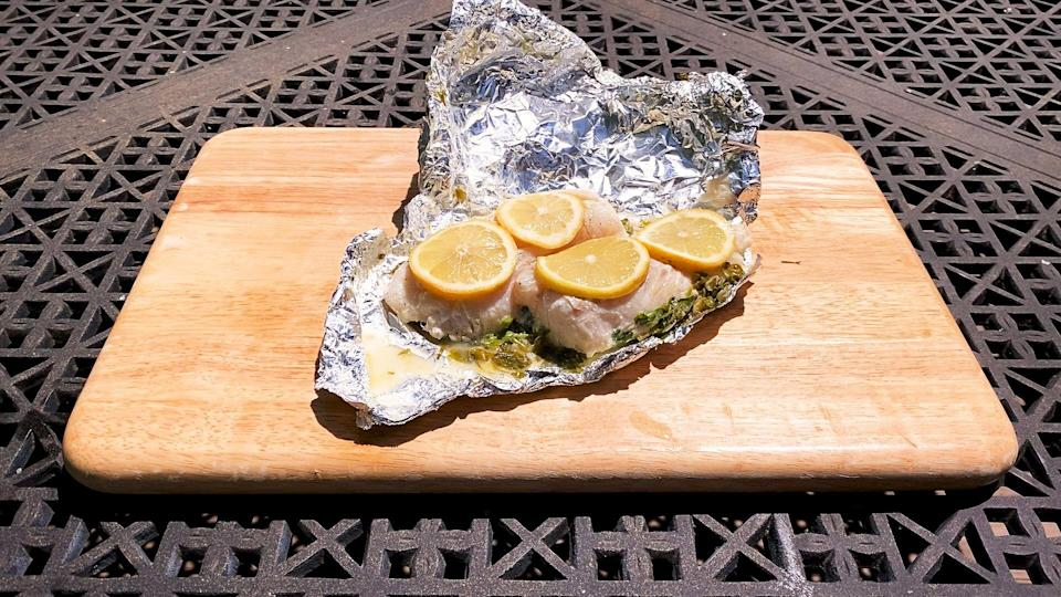 "<p>Foil packets help to keep these cod fillets from breaking apart and cooks the cod to perfection.</p><p>Get the recipe from <a href=""https://www.delish.com/cooking/recipe-ideas/a32676354/grilled-cod-recipe/"" rel=""nofollow noopener"" target=""_blank"" data-ylk=""slk:Delish"" class=""link rapid-noclick-resp"">Delish</a>.</p>"