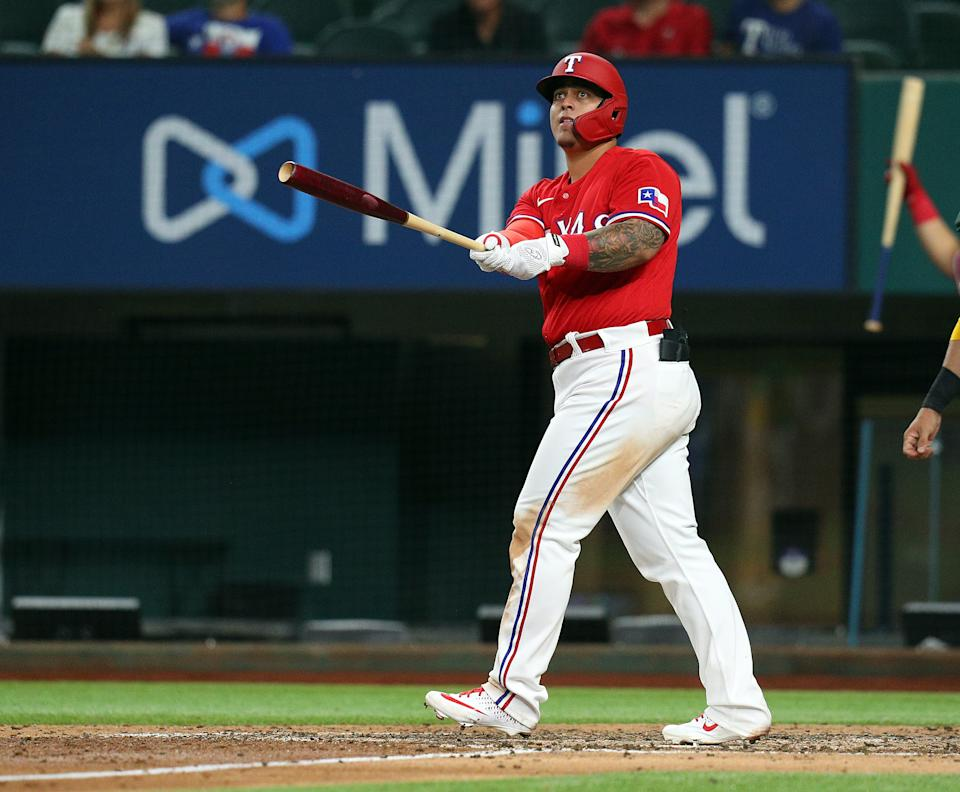 ARLINGTON, TEXAS - AUGUST 13: Yohel Pozo #37 of the Texas Rangers hits a three-run home run in the sixth inning against the Oakland Athletics at Globe Life Field on August 13, 2021 in Arlington, Texas. (Photo by Richard Rodriguez/Getty Images)