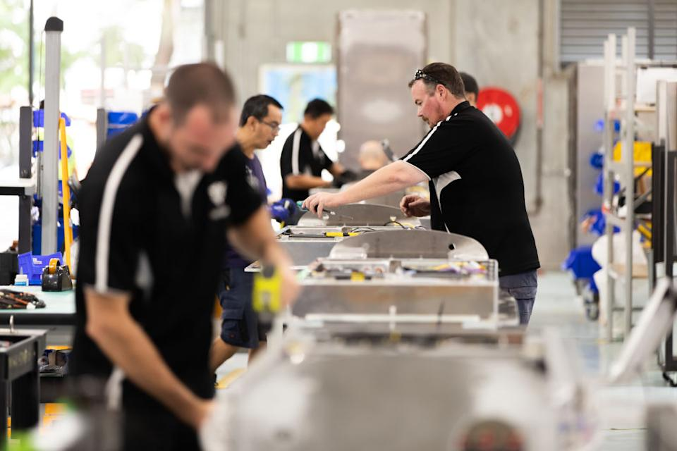 Workers assemble parts for electric vehicle (EV) charging points at the Tritium Pty manufacturing plant in Brisbane, Australia, on Wednesday, March 6, 2019. Photographer: Ian Waldie/Bloomberg