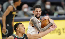 Denver Nuggets guard Austin Rivers, right, pulls in a rebound as Memphis Grizzlies guard Desmond Bane defends in the first half of an NBA basketball game Monday, April 26, 2021, in Denver. (AP Photo/David Zalubowski)