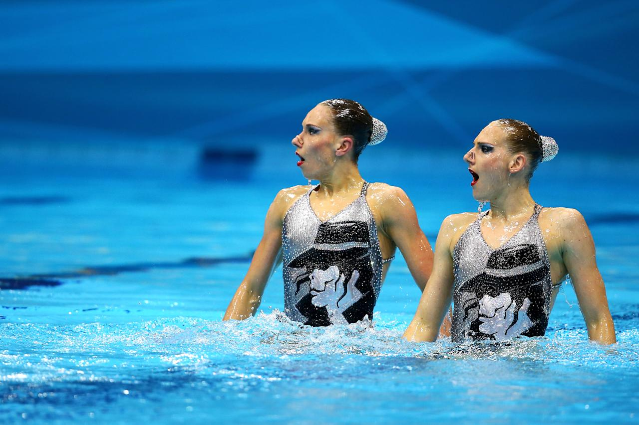 Natalia Ischenko and Svetlana Romashina of Russia compete in the Women's Duets Synchronised Swimming Technical Routine on Day 9 of the London 2012 Olympic Games at the Aquatics Centre  on August 5, 2012 in London, England.  (Photo by Al Bello/Getty Images)
