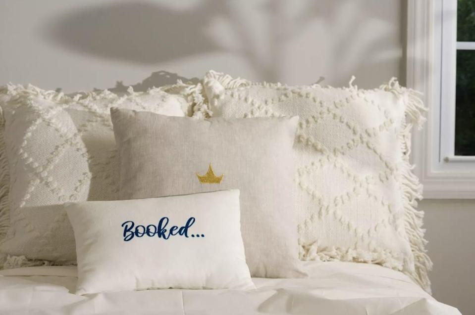 <p>Let people know not to disturb because you'll be spending the weekend cozied up with a good book and this <span>Disney Princess X POPSUGAR Belle Booked for the Weekend Decor Pillow</span> ($30).</p>