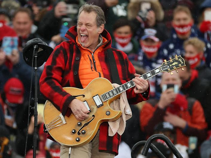 Ted Nugent performs the Star-Spangled Banner during a campaign rally for Donald Trump on 27 October 2020 in Lansing, MichiganChip Somodevilla/Getty Images