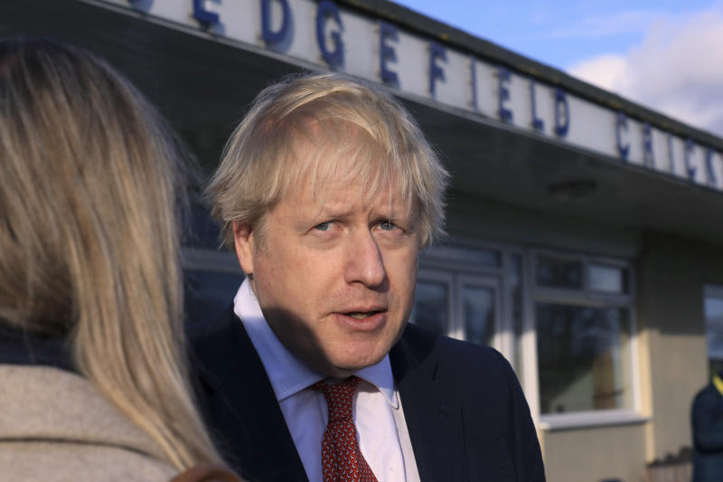 Britain's Prime Minister Boris Johnson, gives an interview during a visit to meet newly elected Conservative party MP for Sedgefield, Paul Howell, at Sedgefield Cricket Club in County Durham, north east England, Saturday Dec. 14, 2019, following his Conservative party's general election victory. Johnson called on Britons to put years of bitter divisions over the country's EU membership behind them as he vowed to use his resounding election victory to finally deliver Brexit. (Lindsey Parnaby/Pool via AP)
