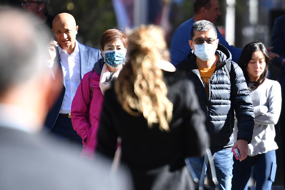 A small number of Sydneysiders wearing masks in the CBD in Sydney on Friday. Source: AAP