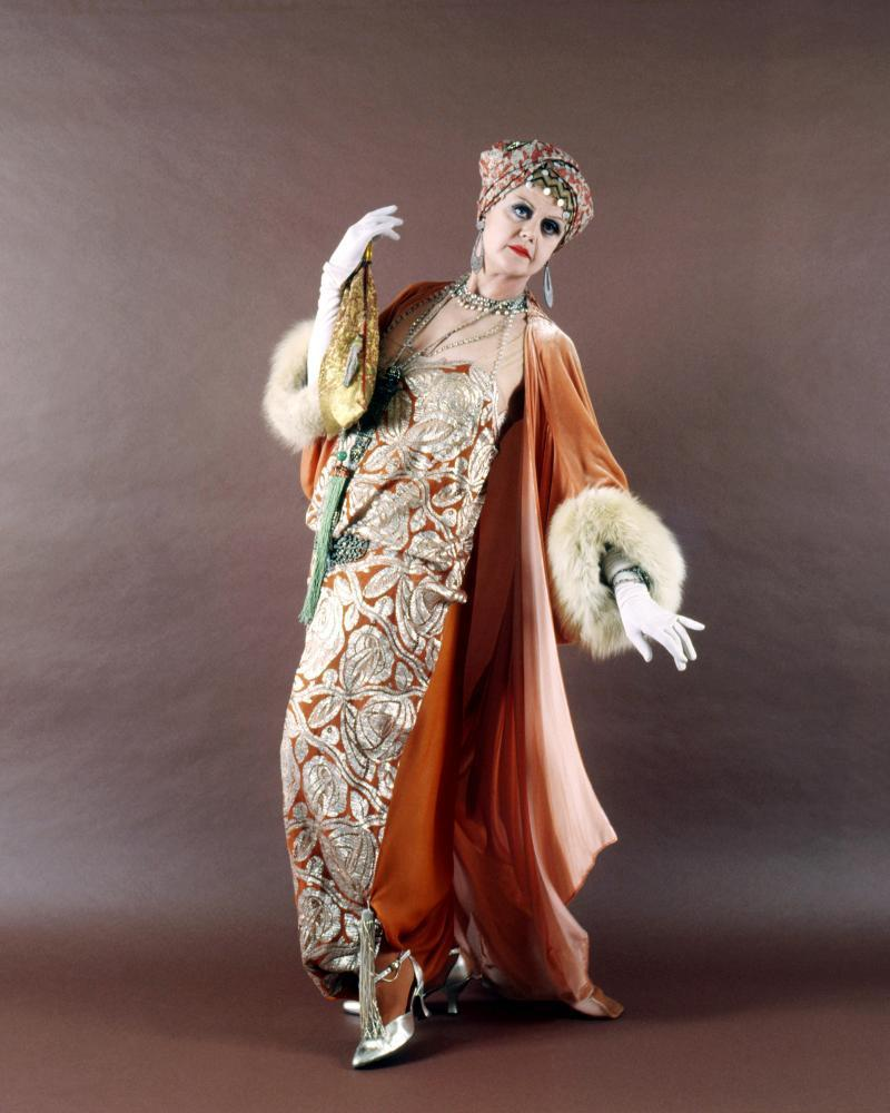 Angela Lansbury as Salome Otterbourne in the film Death on the Nile, 1978. Powell designed Salome's turban and vampish dress – the exotic ensemble is an instant biography.