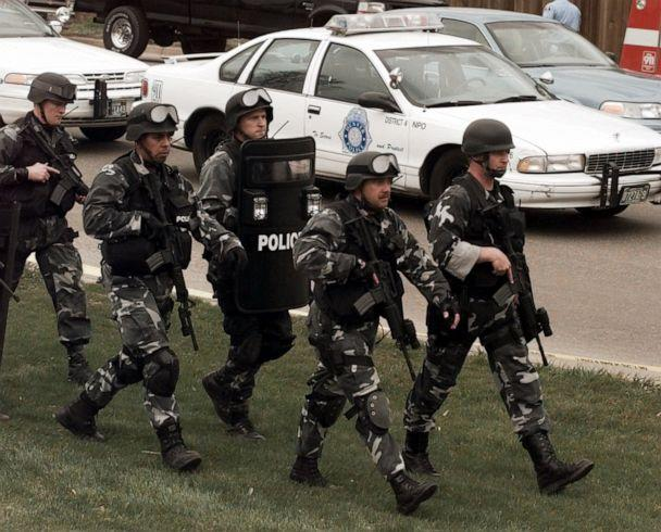 PHOTO: Members of a police SWAT march to Columbine High School in Littleton, Colo., April 20, 1999. (Ed Andrieski/AP, FILE)