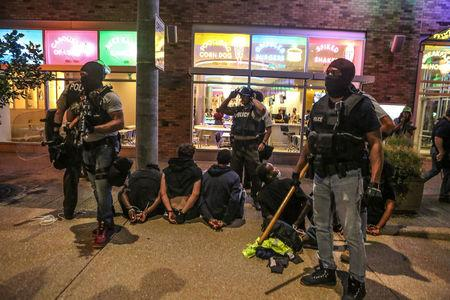 Police detain protesters arrested for causing damage to local businesses during the second night of demonstrations in St. Louis, Missouri, September 16, 2017. REUTERS/Lawrence Bryant