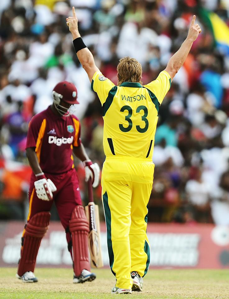 Australian cricket team's stand-in captain Shane Watson (R) celebrates dismissing West Indies batsman Johnson Charles during the third-of-five One Day International (ODI) matches between West Indies and Australia at the Arnos Vale Ground in Kingstown on March 20, 2012. Australia have scored 220/10 at the end of their innings. AFP PHOTO/Jewel Samad (Photo credit should read JEWEL SAMAD/AFP/Getty Images)