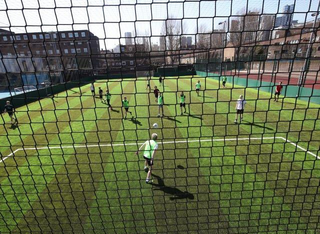 Teams playing seven-a-side football in south London