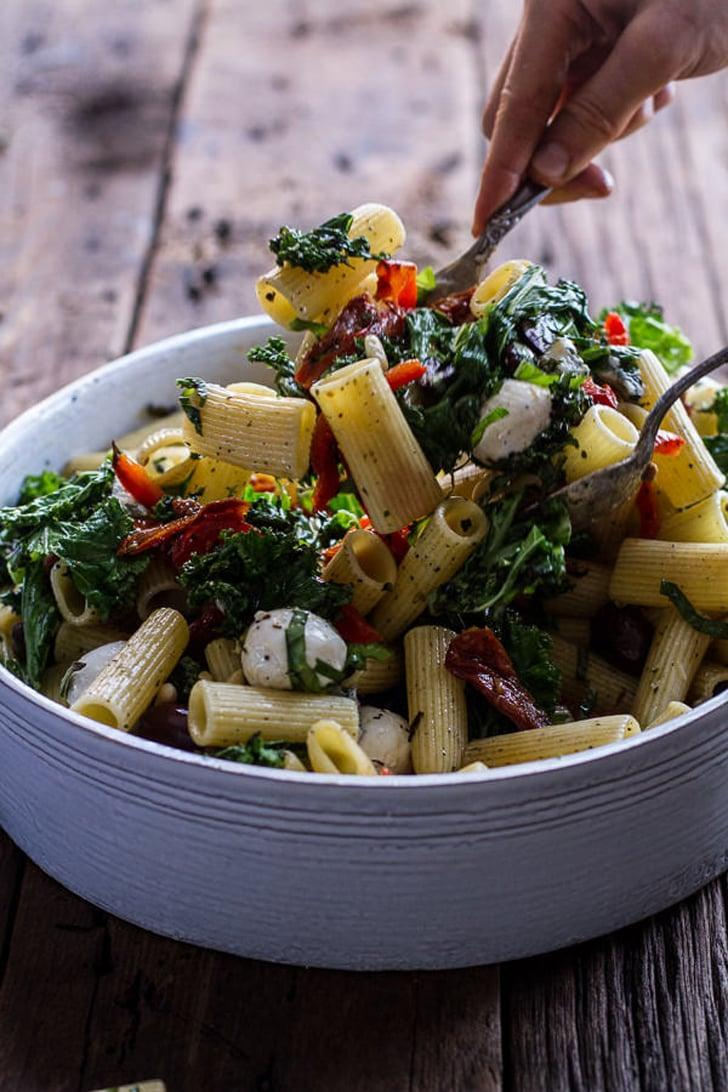 """<p>If you want to impress your guests, cook up this delicious pasta. It has a handful of amazing ingredients like red bell peppers, leafy kale, kalamata olives, pine nuts, and fresh basil, meaning it's big enough to enjoy for days. Dig in!</p> <p><strong>Get the recipe</strong>: <a href=""""http://www.halfbakedharvest.com/simple-grilled-kale-red-pepper-tuscan-pasta-salad/"""" class=""""link rapid-noclick-resp"""" rel=""""nofollow noopener"""" target=""""_blank"""" data-ylk=""""slk:grilled kale and bell pepper pasta salad with mozzarella and blue cheese"""">grilled kale and bell pepper pasta salad with mozzarella and blue cheese</a></p>"""