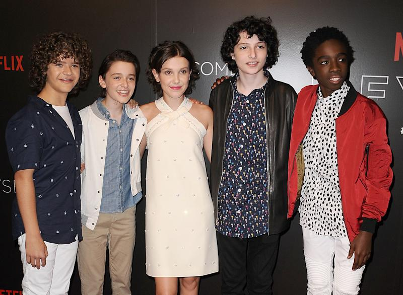 "BEVERLY HILLS, CA - JUNE 06: (L-R) Gaten Matarazzo, Noah Schnapp, Millie Bobby Brown, Finn Wolfhard and Caleb McLaughlin attend the ""Stranger Things"" FYC event at Netflix FYSee Space on June 6, 2017 in Beverly Hills, California. (Photo by Jason LaVeris/WireImage)"