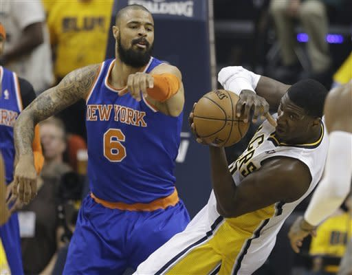 Indiana Pacers' Roy Hibbert grabs a rebound in front of New York Knicks' Tyson Chandler (6) during the first half of Game 6 of an Eastern Conference semifinal NBA basketball playoff series Saturday, May 18, 2013, in Indianapolis. (AP Photo/Darron Cummings)