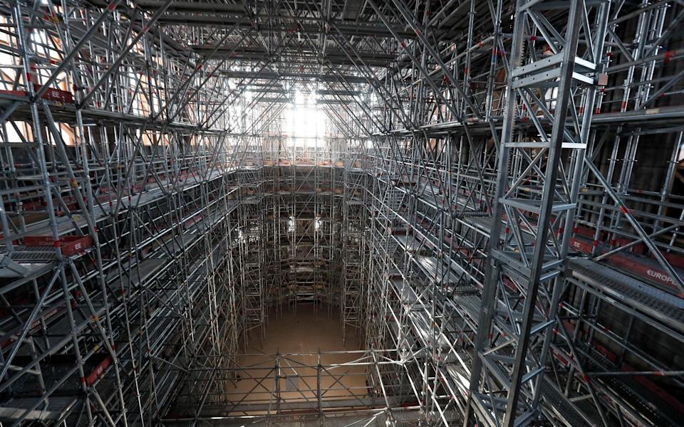 A view of the main scaffolding under the vaults of Notre Dame - AP