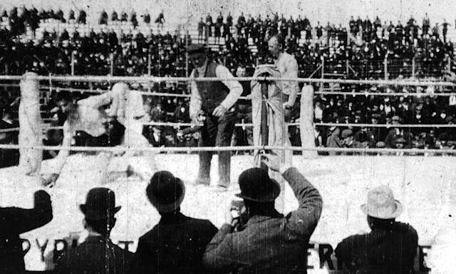 "<span class=""element-image__caption"">Bob Fitzsimmons, right, looks on as he knocks out Jim Corbett in the 14th round to win their world heavyweight championship fight on March 17,1897 in Carson City, Nevada.</span> <span class=""element-image__credit"">Photograph: The Ring Magazine/Getty Images</span>"