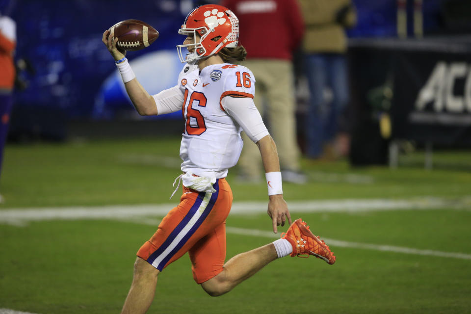 Clemson quarterback Trevor Lawrence (16) runs in for a touchdown during the second half of the Atlantic Coast Conference championship NCAA college football game against Notre Dame , Saturday, Dec. 19, 2020, in Charlotte, N.C. (AP Photo/Brian Blanco)
