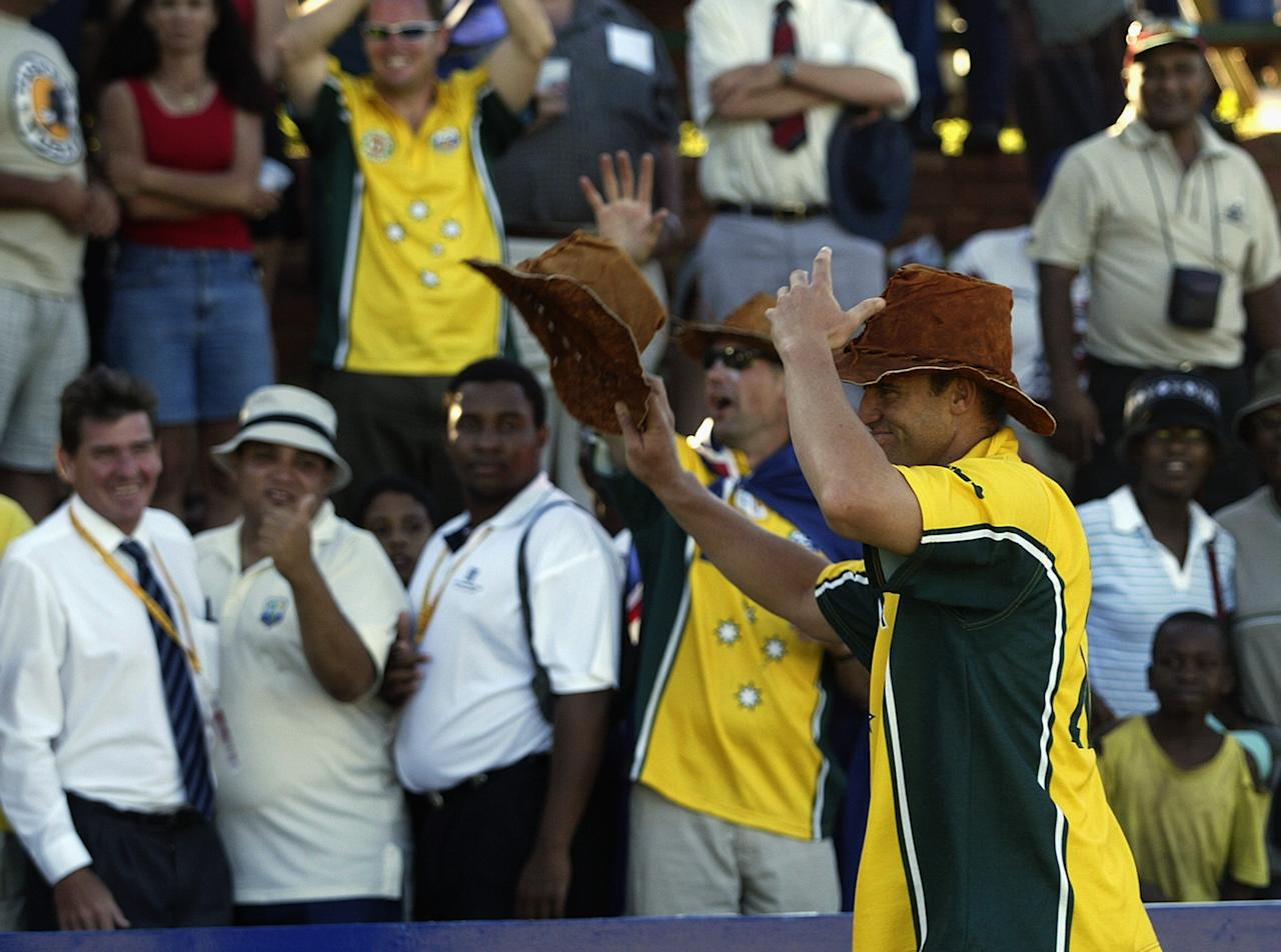 BULAWAYO - FEBRUARY 24:  Matthew Hayden of Australia is given a hat by Australian fans after the ICC Cricket World Cup 2003 Pool A match between Zimbabwe and Australia held on February 24, 2003 at Queens Park, in Bulawayo, Zimbabwe. Australia won the match by 7 wickets. (Photo by Hamish Blair/Getty Images)